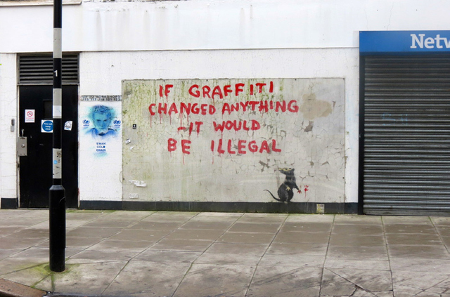 STREET ART BY BANKSY THAT THE LONDON BOROUGH OF CAMDEN COUNCIL OPTED TO PROTECT WITH PLEXIGLASS