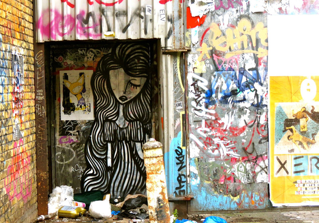 THIS PAINTING OF A WOMAN JUXTAPOSED WITH GARBAGE AND GRAFFITI SCRAWLS WAS INSPIRATION FOR THE TITLE OF THIS PAPER