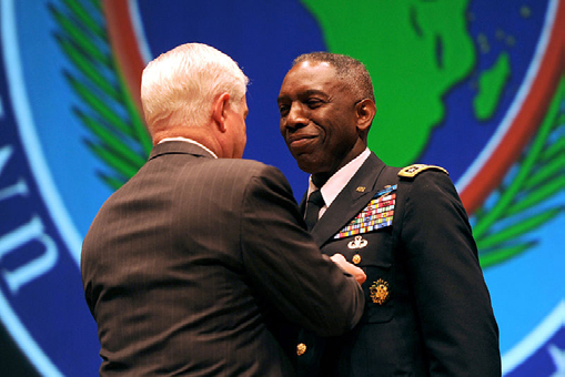EX-SECRETARY OF DEFENSE, ROBERT M. GATES, PRESENTS THE DEFENSE DISTINGUISHED SERVICE MEDAL TO OUTGOING COMMANDER OF AFRICOM, GENERAL WILLIAM WARD, DURING THE AFRICOM CHANGE OF COMMAND CEREMONY