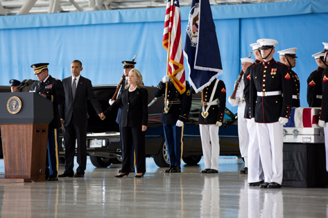 President Obama and Secretary of State Hilary Clinton stand during the transfer of remains ceremony, celebrating the sacrifice of Christopher Stevens, Sean Smith, Glen Doherty and Tyrone Woods, who were killed in the attack