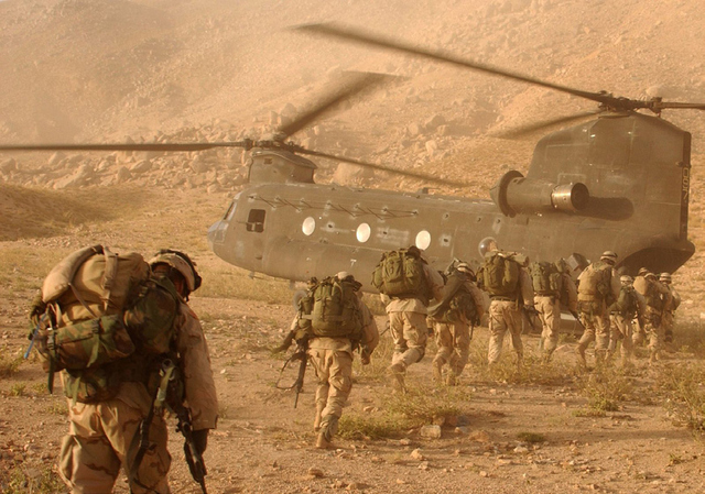 US soldiers board a CH-47 Chinook helicopter during a military operation in Afghanistan.