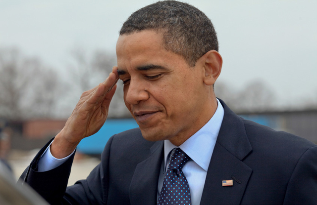President Barack Obama salutes at Andrews Air Force Base before departing for Columbus, Ohio in March of 2009