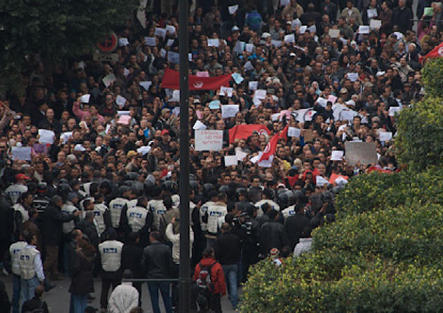 Tunisian protestors take to the streets, sparking the Arab Spring.