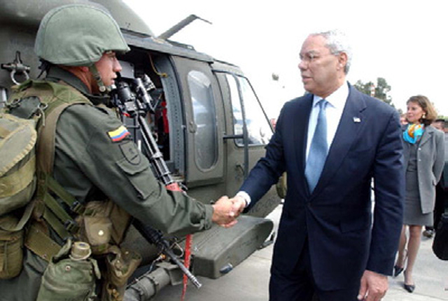 Fmr. Secretary of State Colin Powell greeting Colombian Military personnel.