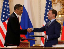 Barack Obama and Dmitri Medvedev shake hands after signing the New START Treaty.