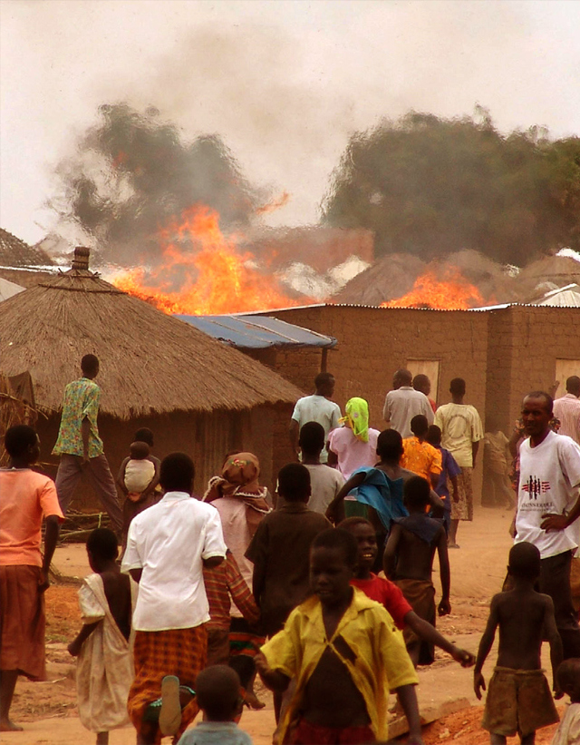 A fire sweeps through a refugee camp for those displaced by the conflict between the Lord's Resistance Army and the Ugandan Government