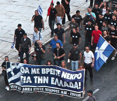 Golden Dawn demonstration in Athens June 27, 2012. The sign reads 'Watch me die for Greece'