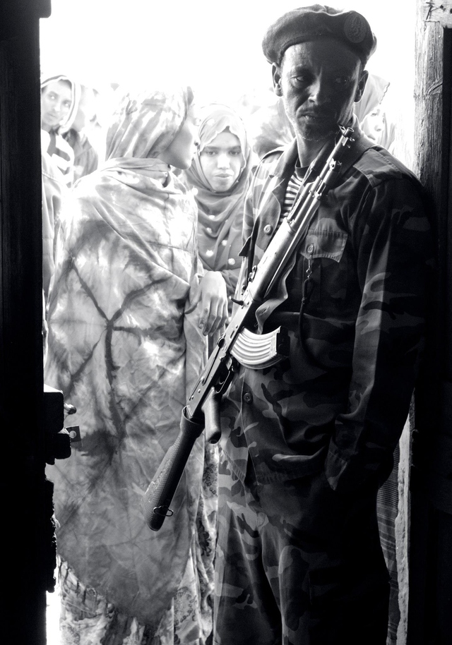 Somaliland soldier at the doorway to a polling center during 2012 elections.