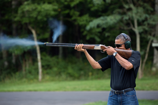 President Obama firing a shotgun at Camp David