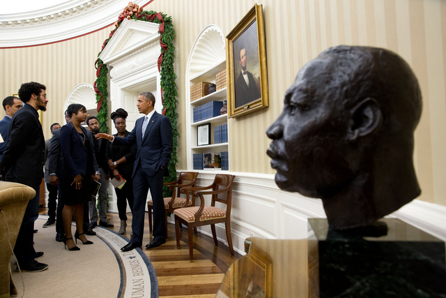 President Obama with a bust of Martin Luther King Jr. in the foreground
