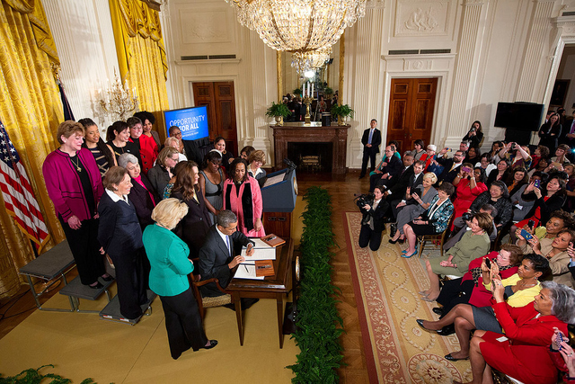 President Obama signs executive actions to strengthen enforcement of equal pay laws for women, at an event marking Equal Pay Day in the East Room of the White House, April 8, 2014.