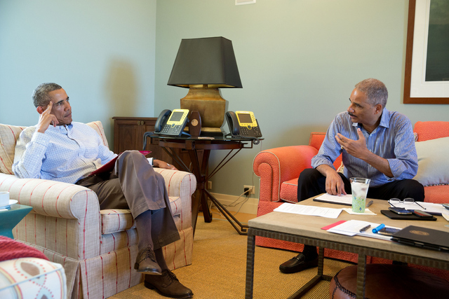 Attorney General Eric Holder with President Obama in the wake of the shooting incident in Ferguson, MO
