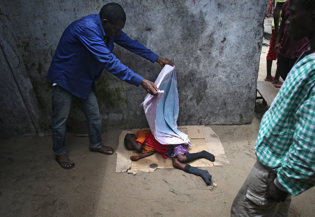 A young ebola victim is covered with a sheet in Monrovia, Liberia