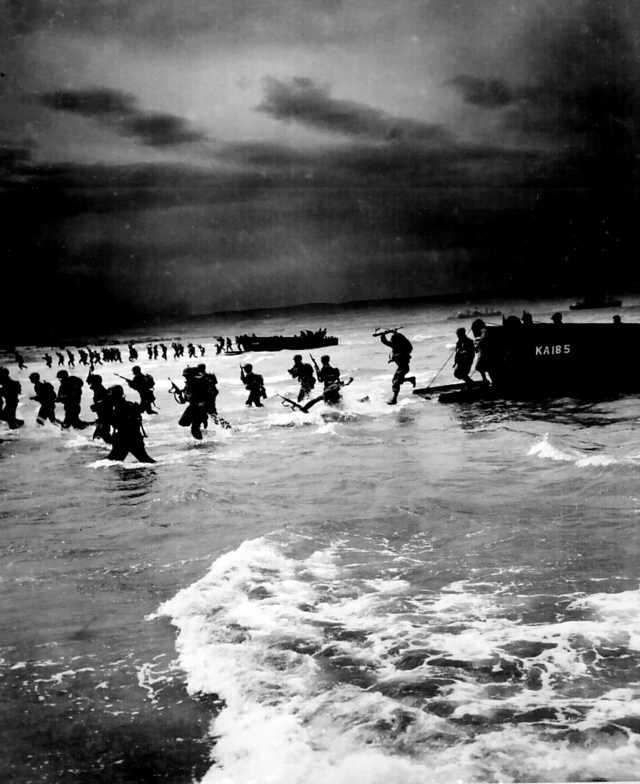 US troops storm a beach in North Africa during World War II.