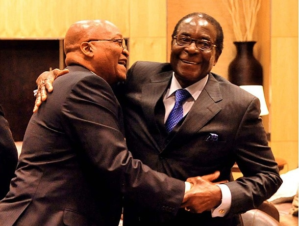 South African President Zuma embraces Zimbabwean President Mugabe at a Zanu-PF conference.