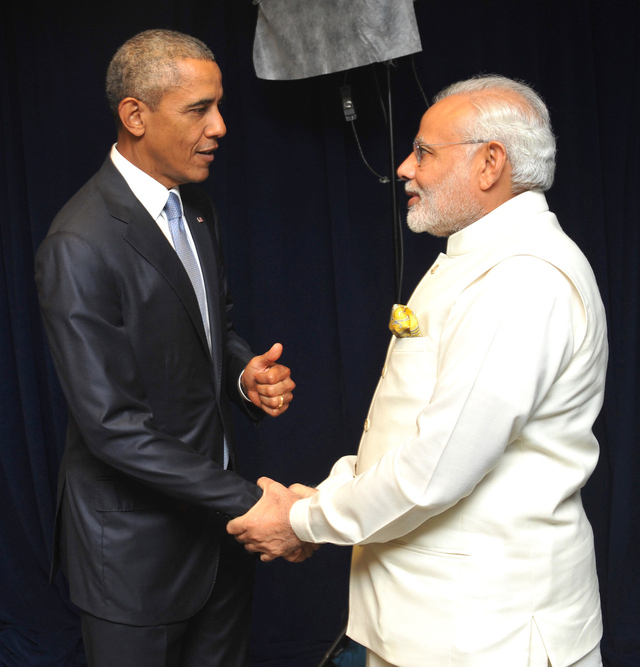 President Barack Obama shaking hands with Prime Minister Narendra Modi.