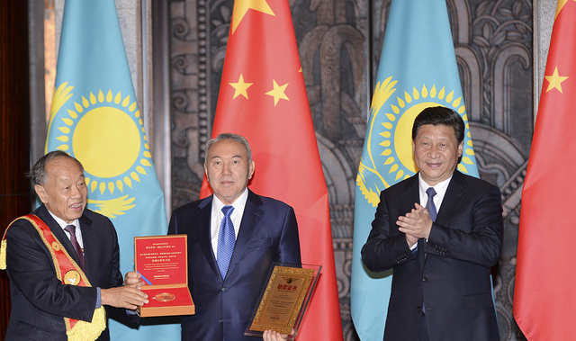 President Nazarbayev and President Xi Jinping, pictured center and right, at a talk before Xi Jinping accepted a peace prize for his New Silk Road vision.